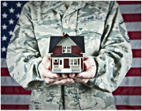 Veteran home buyer holding a model home