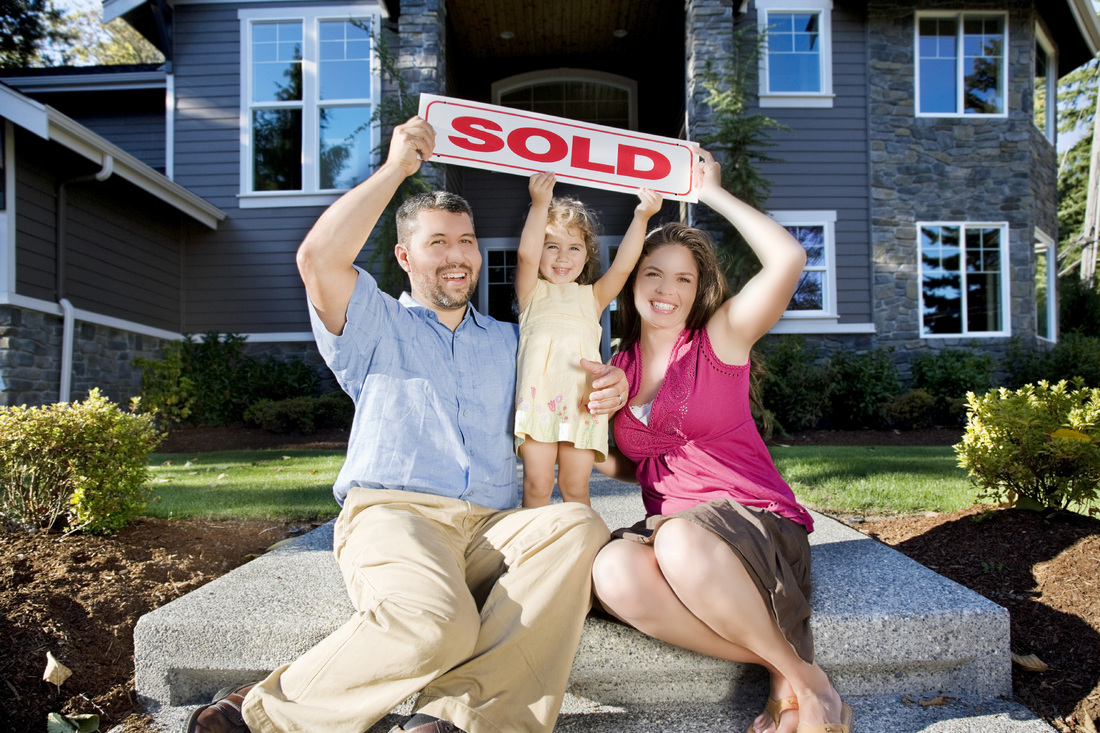 Happy family who just sold their house